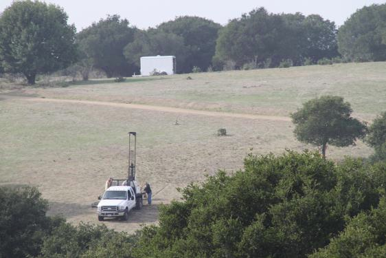 View of the drilling truck (bottom) and the white trailer (top) on the grasslands trailer