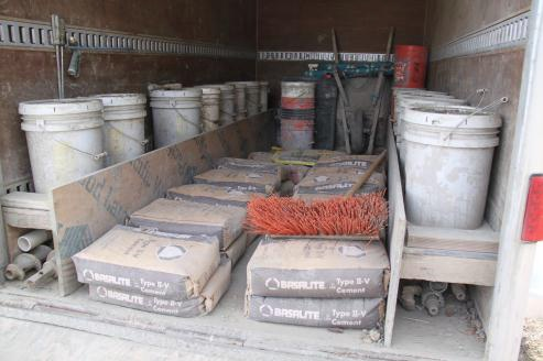 Heavy trailer load – concrete mix, water, tools, drill bits